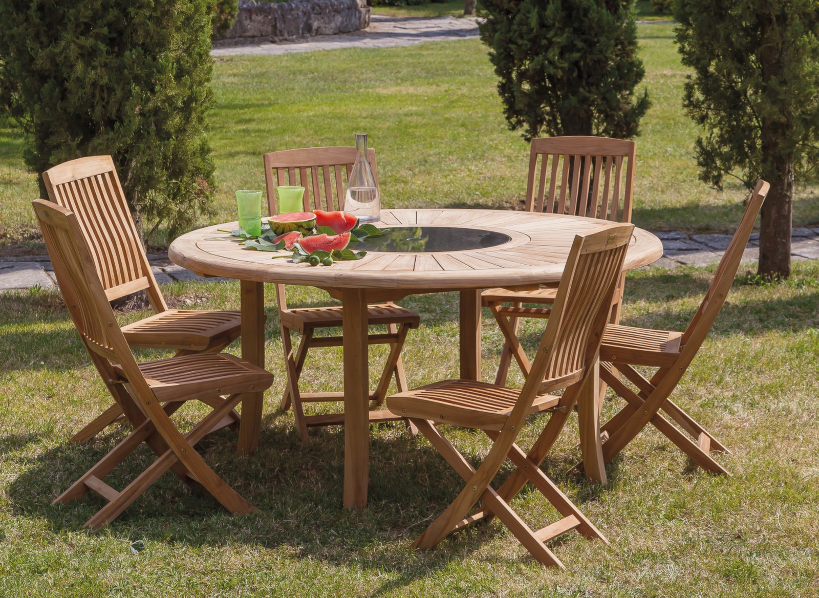 Table de jardin ronde en teck brehat 155cm proloisirs for Table 4 en 1 intersport