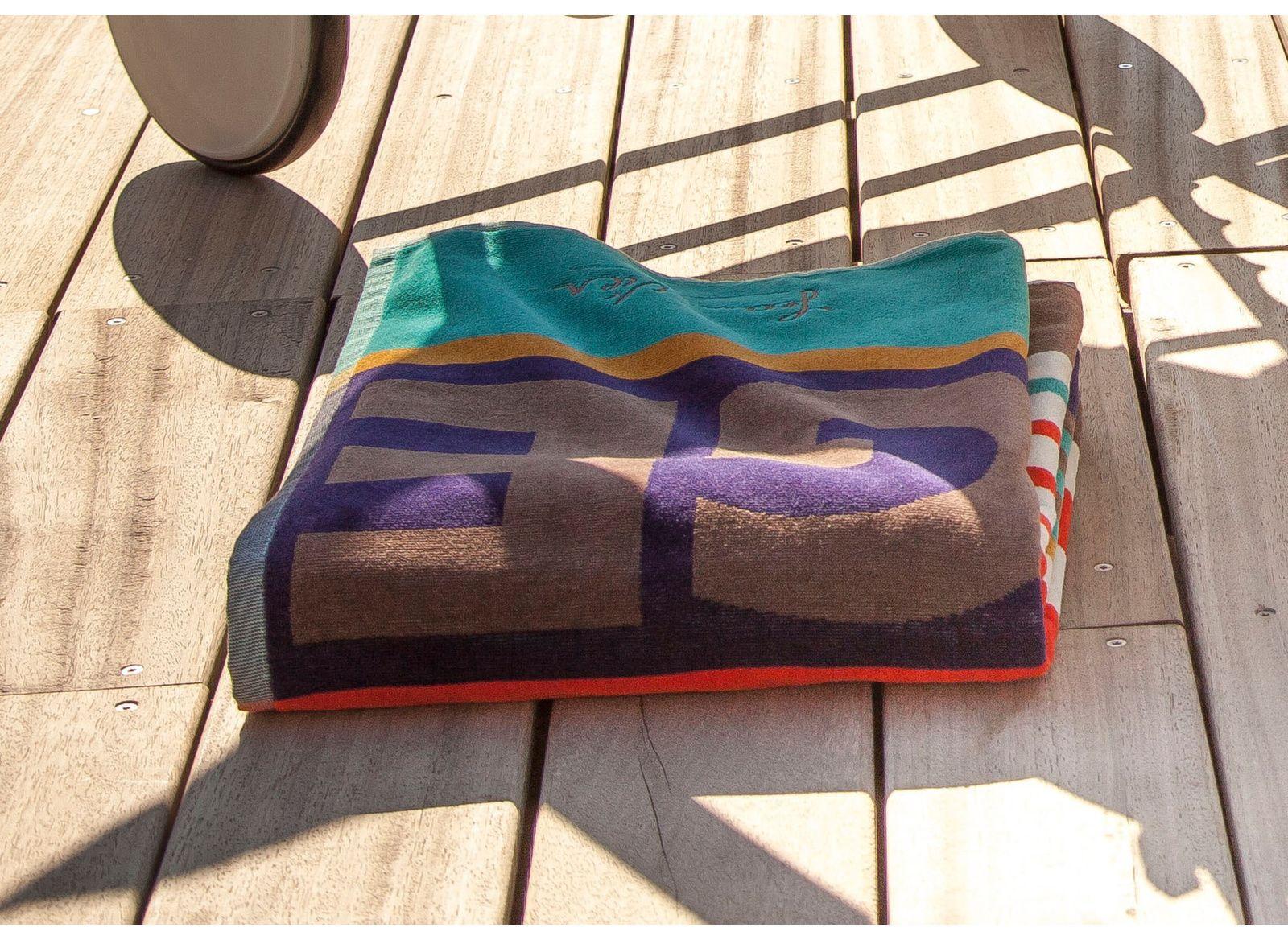 Bain de soleil Théma + drap de bain